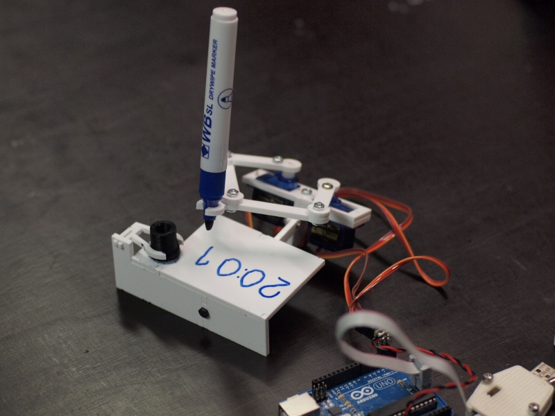 3D-printed Plotclock writes the time on a tiny whiteboard every